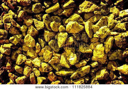 Gold Stones Gravel Texture Macro Background High Contrasted With Vignetting Effect