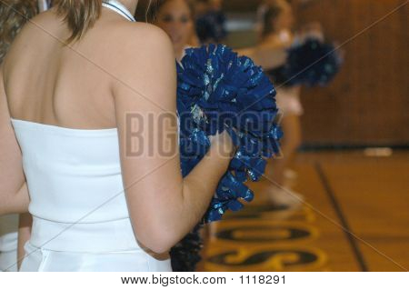 Cheerleader And Pom Poms