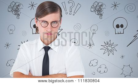 Geeky businessman looking at camera with arms crossed against grey vignette