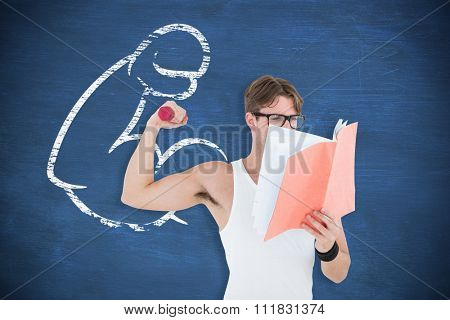 Geeky hipster lifting dumbbells and reading notepad against blue chalkboard