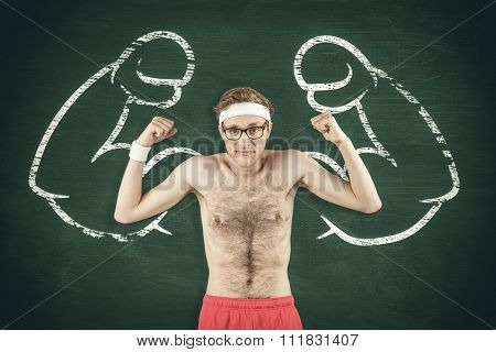 Geeky shirtless hipster flexing biceps against green chalkboard