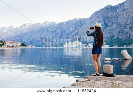 Girl Taking Photo Of Cruise Liner