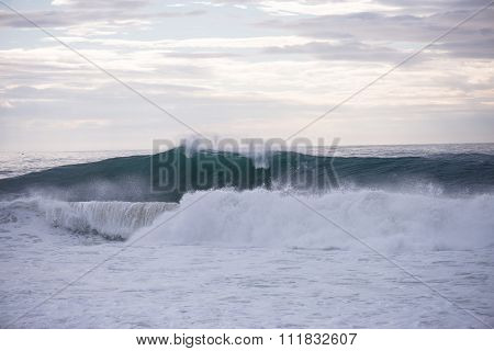 Wave Crashing On A Coast In Nazare