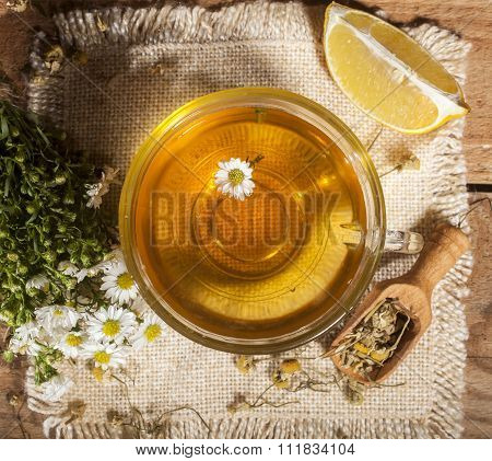 Chamomile tea on wooden background