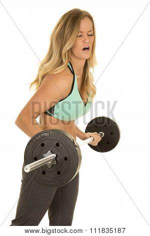 Woman In Green Sports Bra Curl Barbell Heavy