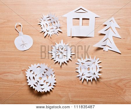 Paper Snowflakes And Other Decoration On Table