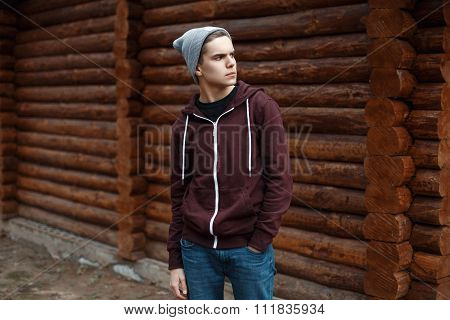 Young Stylish Guy In The Background Of A Wooden House