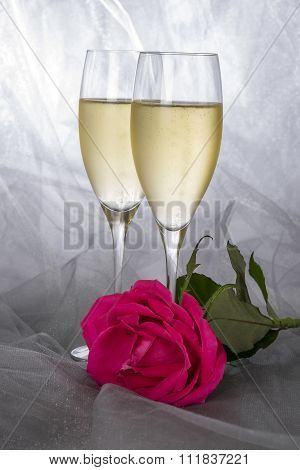 Two Glasses of Champagne and a Single Pink Rose
