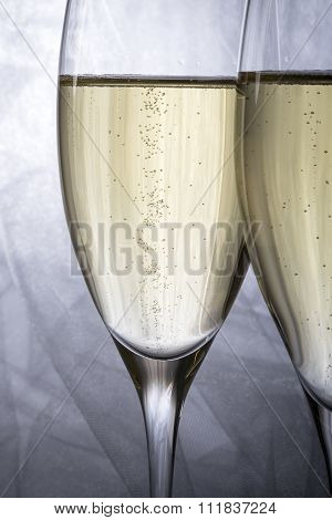 Closeup of Two Glasses of Champagne on Grey Background