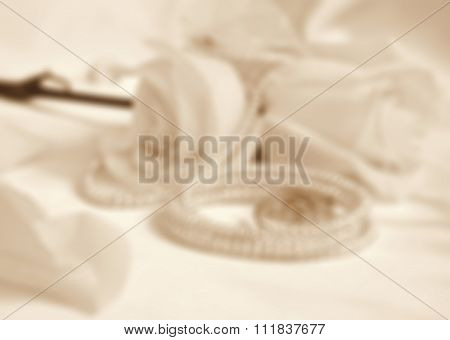 Wedding Rings And Roses In Blur Style As Wedding Background. In Sepia Toned. Retro Style