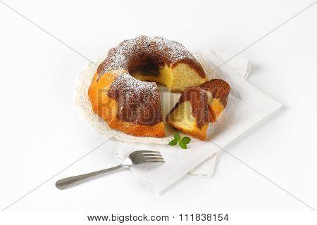 sliced marble bundt cake on white napkin