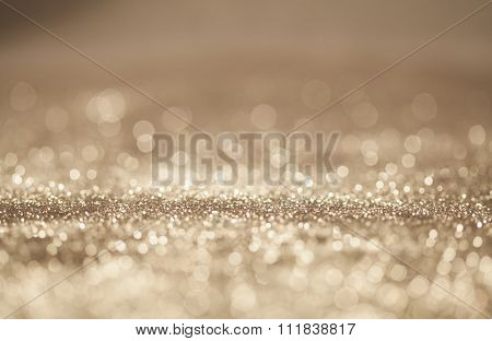Golden Christmas and New Year bokeh, blinking background with copyspace