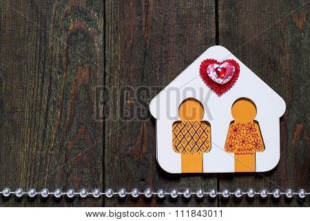 Wooden House With Little Man And Heart