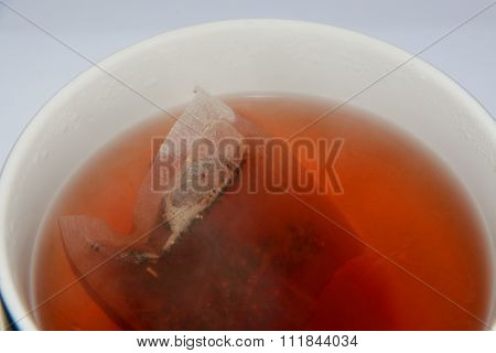 Red raspberry herbal tea in cup