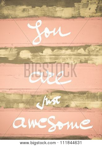 Concept Image Of You Are Just Awesome Motivational Quote Hand Written On Vintage Painted Wooden Wall