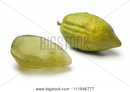 Fresh green Citrus medica and succade on white background