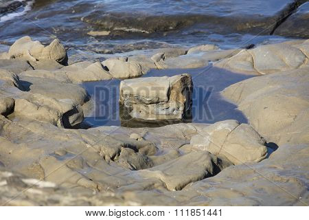 Solitary Rock In Pool Of Water And Reflection At La Jolla California