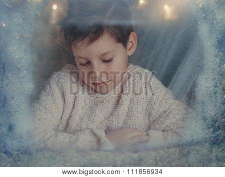 boy at the winter window