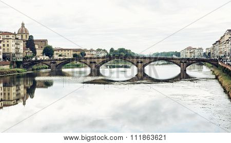 Beautiful Ponte Santa Trinita Is Mirrored In The River Arno, Florence, Italy