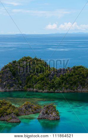Small green Islands belonging to Fam Island in the sea of Raja Ampat, Papua New Guinea
