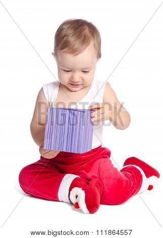 Funny Baby In Santa Claus  Trousers On White Background