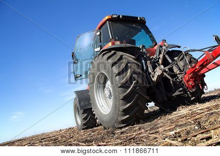 Red Tractor With Plow