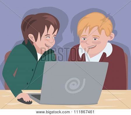 two boys in front of computer