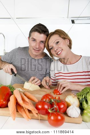Young American Couple Working At Home Kitchen Preparing Vegetable Salad Together Smiling Happy
