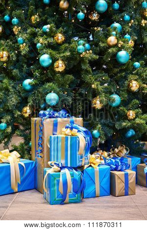 Christmas Tree With Balls And Gifts Beautifully Wrapped