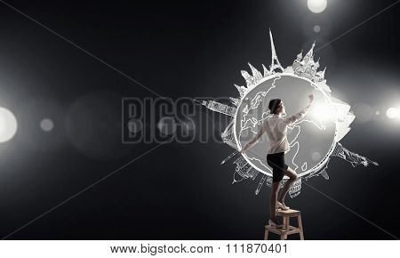 Businesswoman standing on chair and reaching travel concept