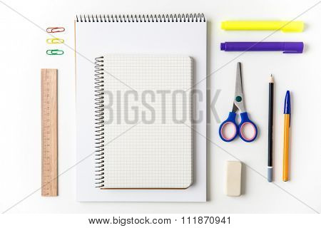 Top view of school and office supplies set isolated over white background