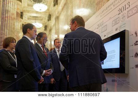 ST. PETERSBURG, RUSSIA - DECEMBER 14, 2015: Russian Minister of Culture Vladimir Medinsky (left) opened the exhibition Territory Of Culture during 4th St. Petersburg International Cultural Forum
