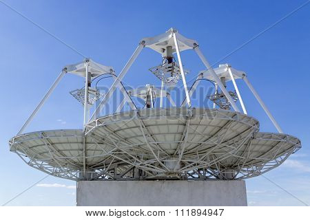 Satellite Dishes On Background Sky