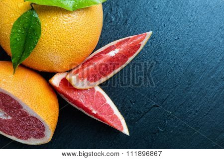 Fresh grapefruit placed on black stone. Shot from aerial view