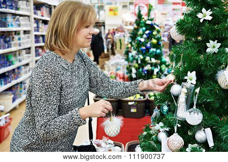 Beauty Woman Choose Toys For Christmas Tree