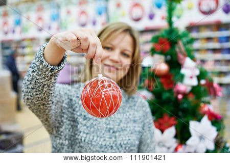 Beauty Woman With Red Ball For The Christmas Tree