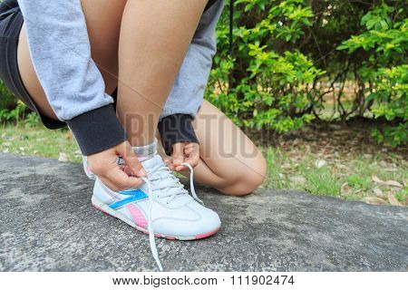Athlete Girl Tying Running Shoes Getting Ready For Jogging