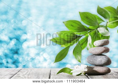 Still life of spa stones on bright background