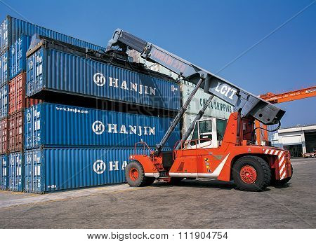 Crane in ports shipyard, moving containers