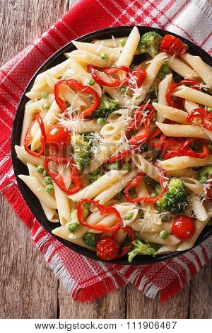 Italian Pasta With Vegetables Close-up On A Plate. Vertical Top View