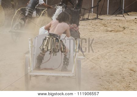 Soldier, Roman chariot in a fight of gladiators, bloody circus