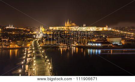 Aerial Night View On Charles Bridge And Prague Castle