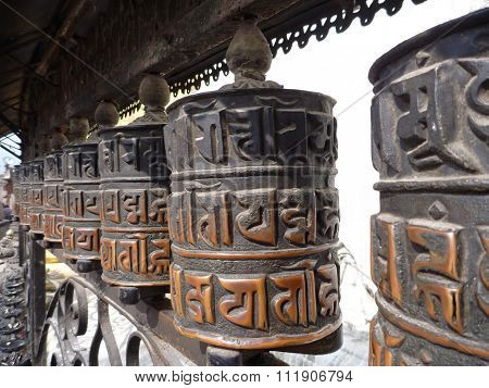 Buddhist Prayer Wheels In A Monastery