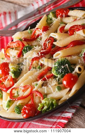 Italian Pasta Primavera With Parmesan Close-up. Vertical