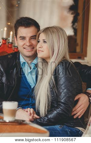 A young couple spends time in a city cafe
