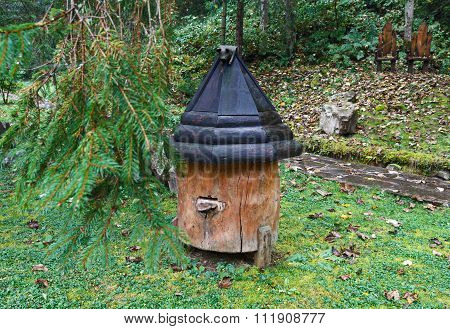 Wooden Beehive And Falling Leaves On A Rainy Day