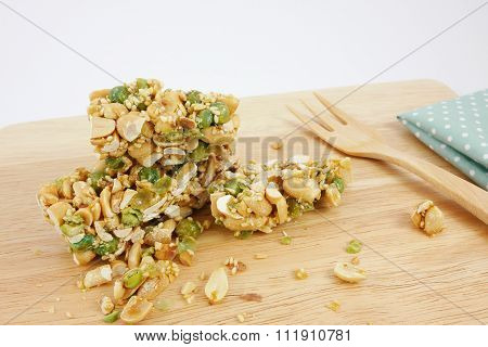 Chinese sesame peanut brittle and green fabric