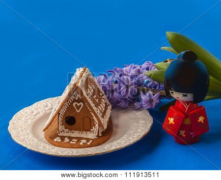 Gingerbread House  With Congratulations In Japanese On The Blue Background