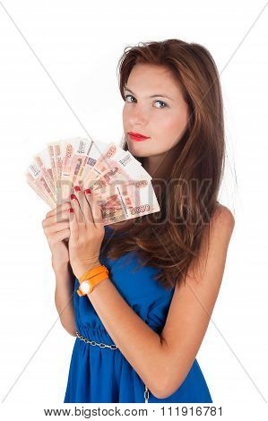 Young pretty woman with freckles holds cash