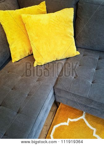 Gray Sofa With Yellow Cushions